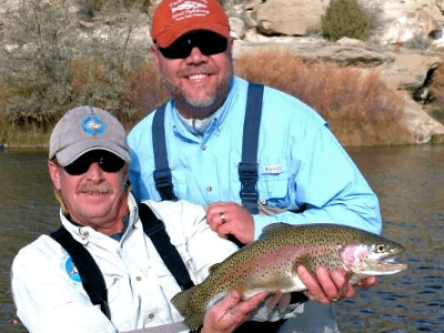 Capt. Mark and his client both look very satisfied over this big rainbow trout on the San Juan.
