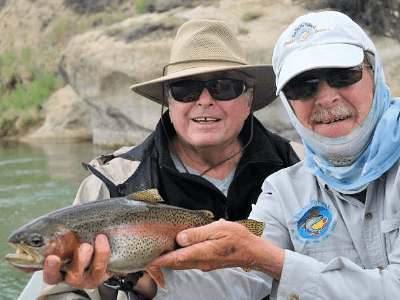 Our Blue Sky client catches another spectacular rainbow trout on our famous NM river.